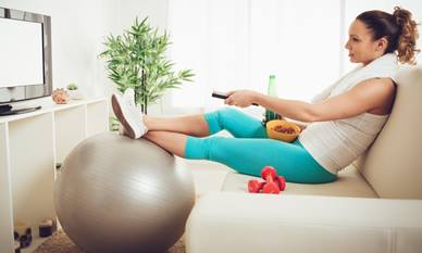 Woman sat watching tv