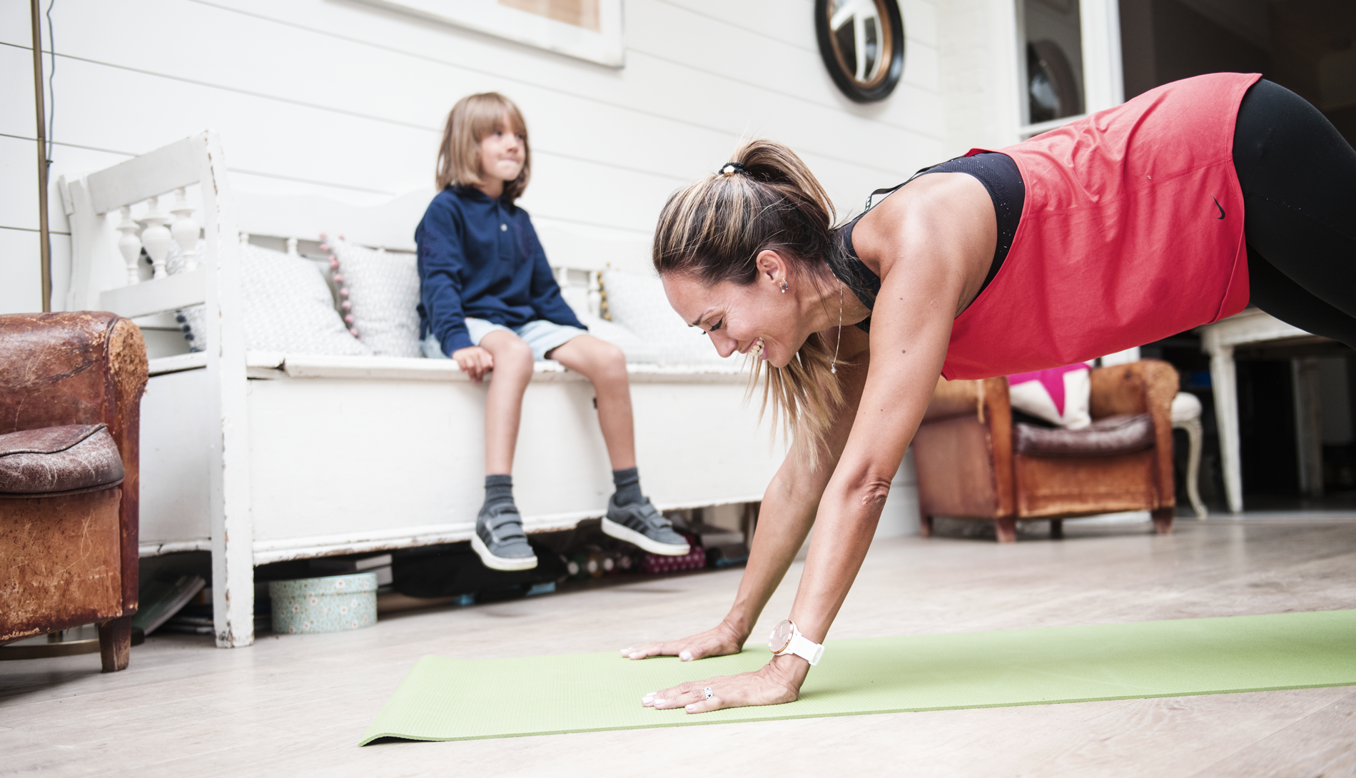 Woman doing exercise on mat