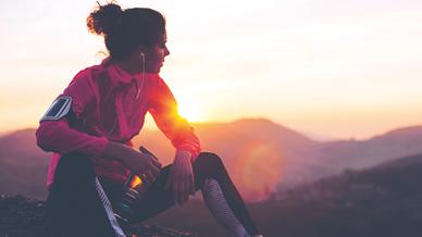 Woman sat watching sunrise