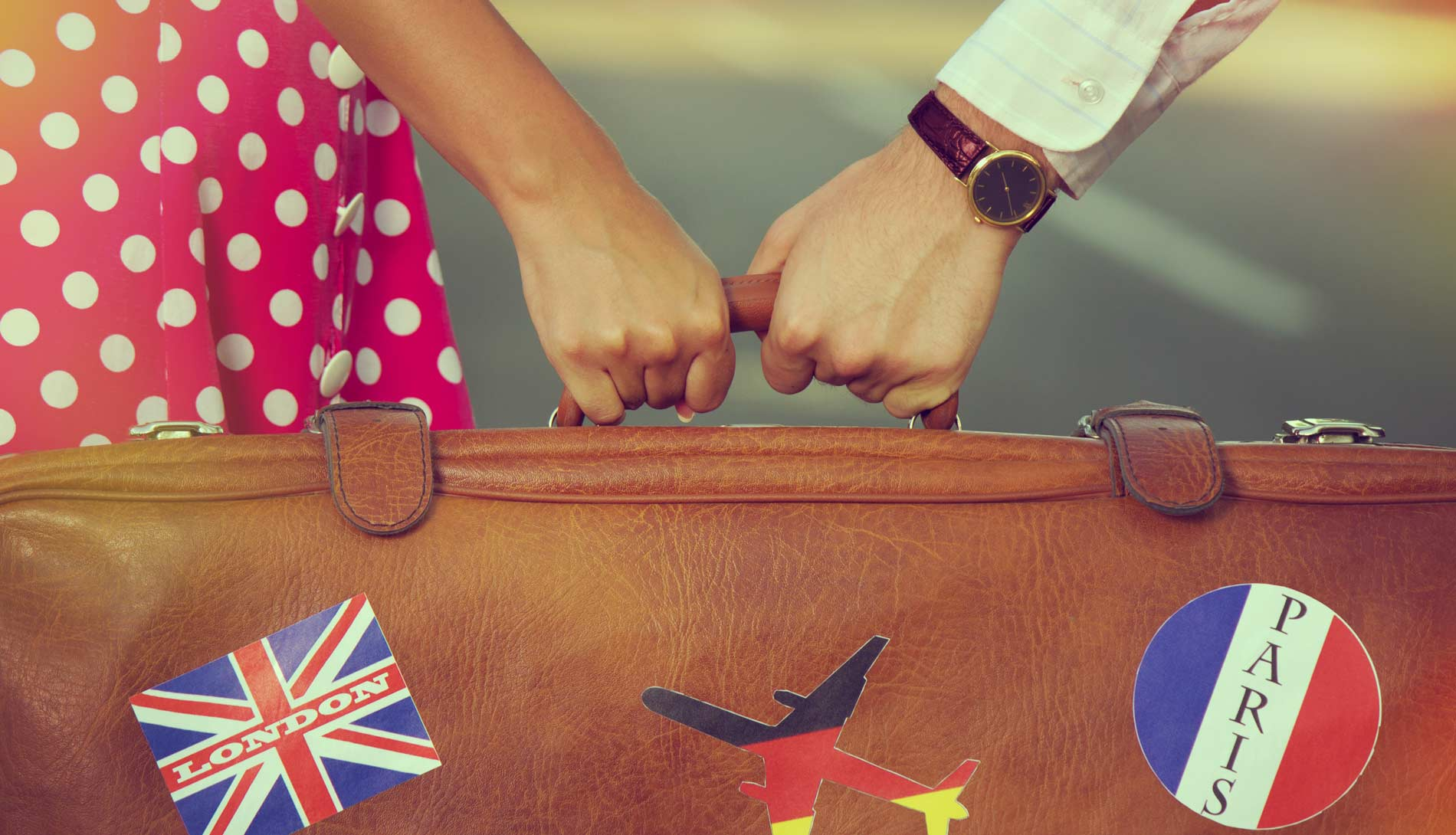 Couple holding suitcase