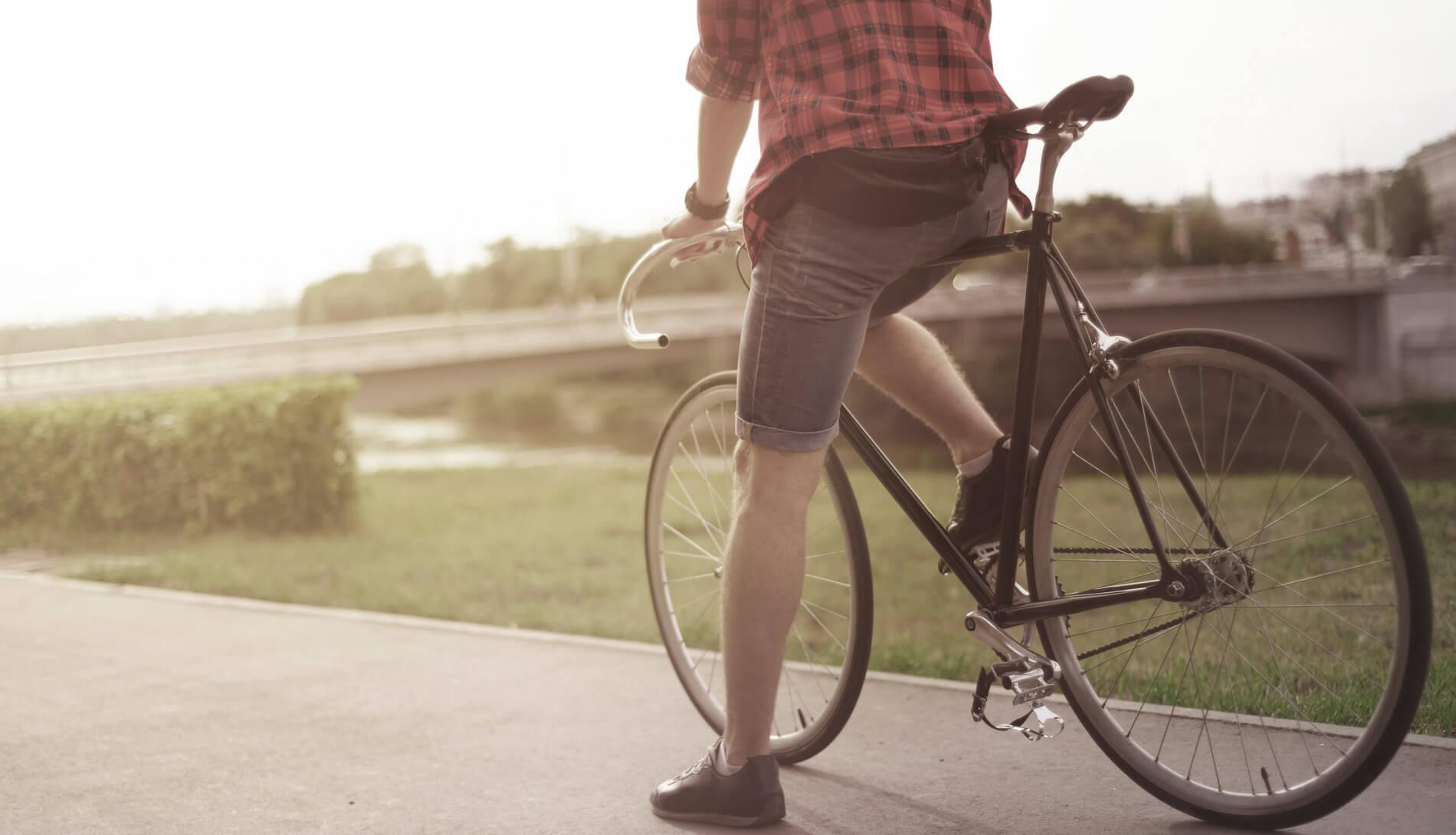 Cyclist resting on path