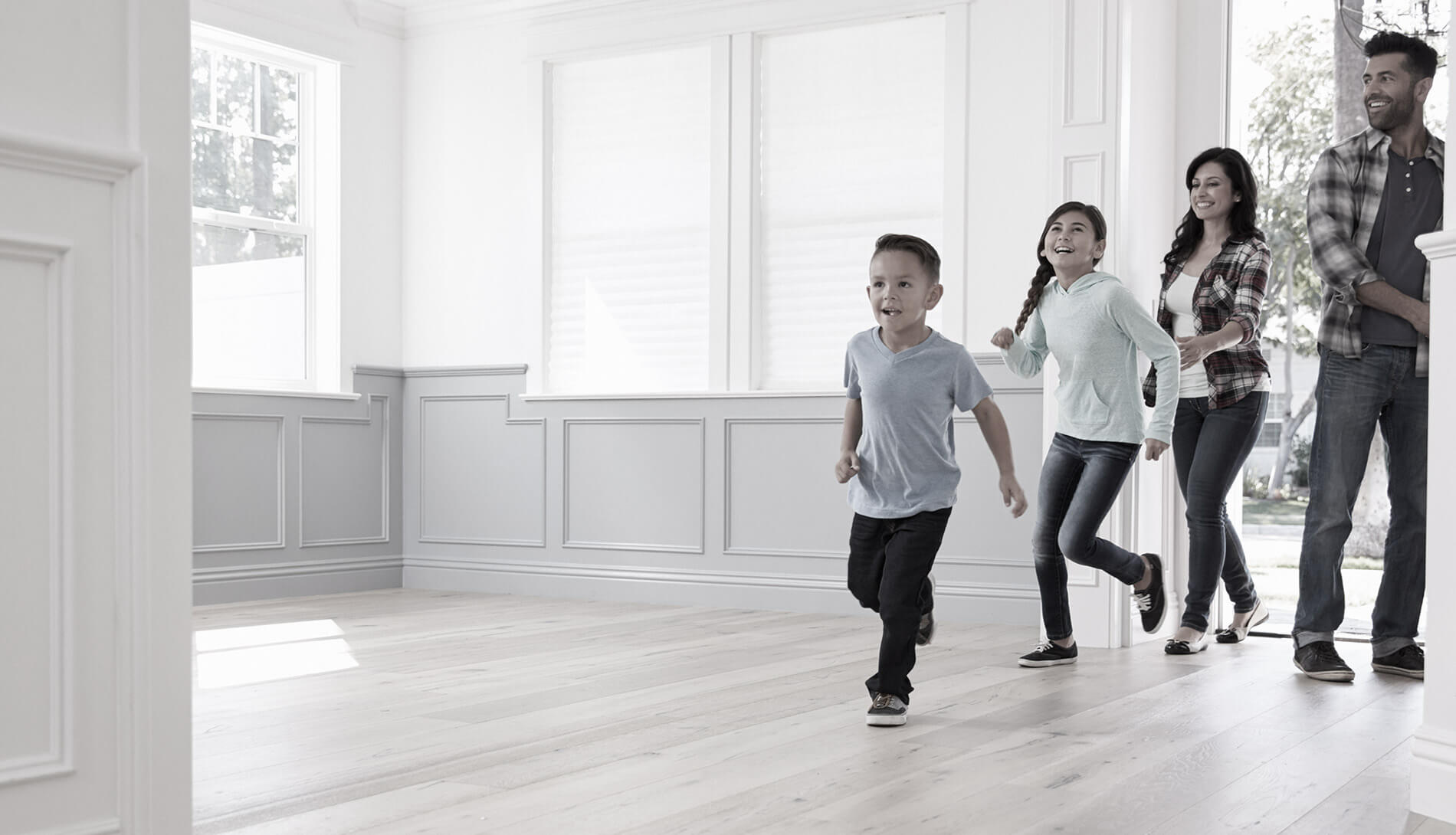Family entering empty house together
