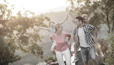 family walking outside smiling