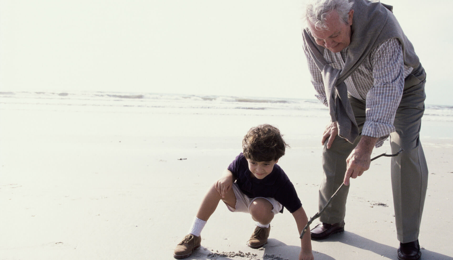 Man and boy playing on the beach