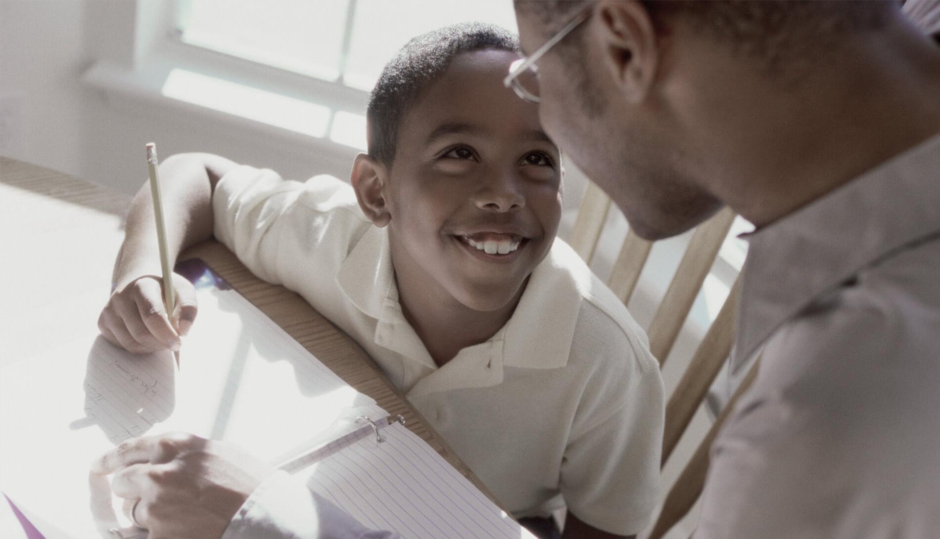 Smiling child studying