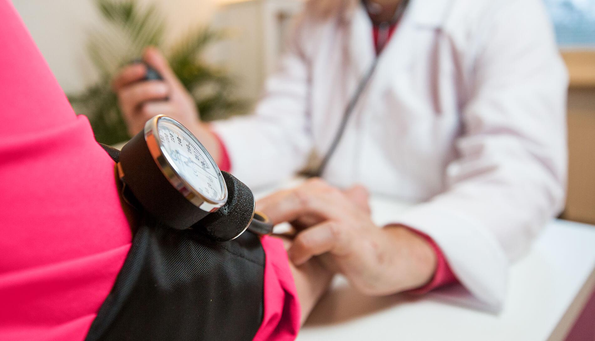 Patient having their blood pressure taken