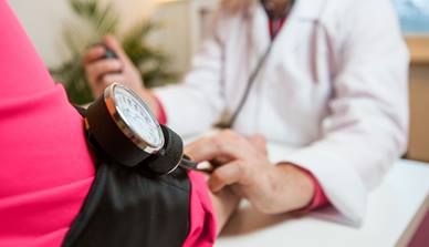 Patient having their blood pressure taken