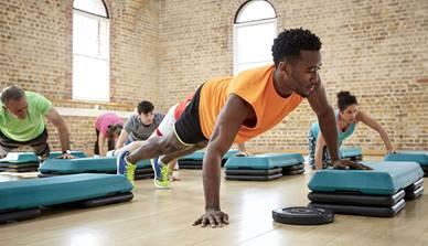 Man in gym doing pushups