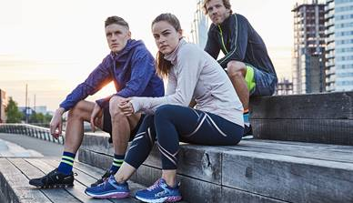 Runners Need members sitting on steps