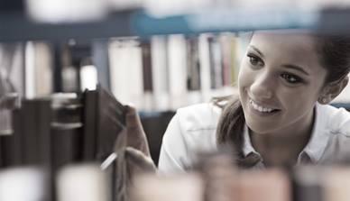 Woman using library shelf